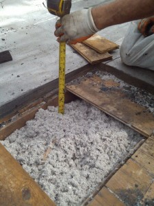 Typical cellulose insulation in a flat roof cavity of a Multi-Family Building.